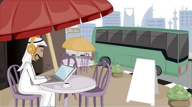 Homme arabe travaillant en ligne avec un ordinateur portable dans un café