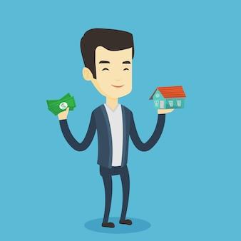 Homme asiatique achetant une maison grâce à un prêt.