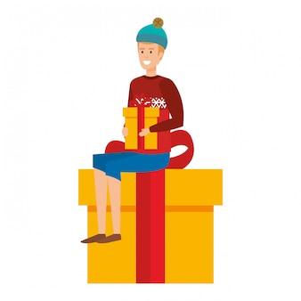 Homme assis en cadeau avec des vêtements de noël