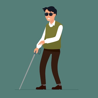 Homme aveugle avec le bâton