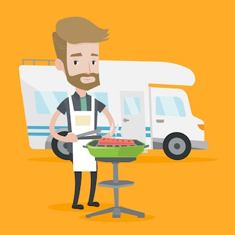 Homme ayant un barbecue devant le camping-car.