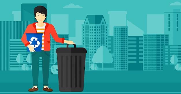 Homme avec des bacs de recyclage