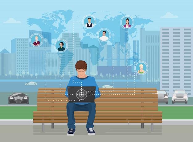 Homme sur banc travaillant avec un ordinateur portable