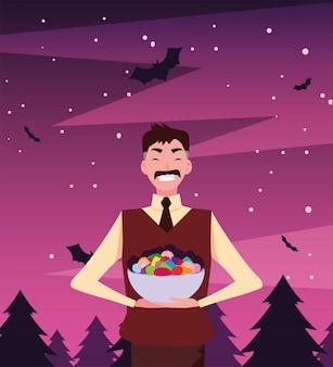 Homme avec des bonbons dans la nuit d'halloween