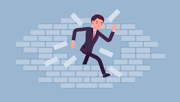 Homme brisant le mur de briques