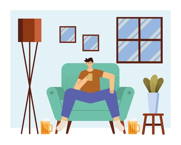Homme buvant de la bière dans le salon