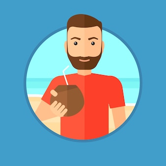 Homme buvant un cocktail de noix de coco sur la plage.