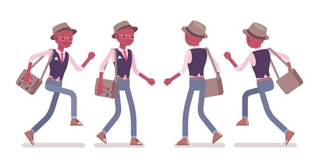 Homme casual intelligent intelligent noir portant chapeau, lunettes marchant, exécutant
