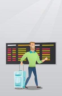 Homme caucasien, marche, à, valise, à, les, aéroport
