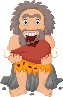 Homme des cavernes cartoon manger de la viande