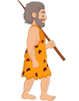 Homme des cavernes dessin animé tenant la lance