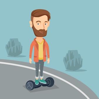 Homme à cheval sur un scooter électrique à équilibrage automatique.
