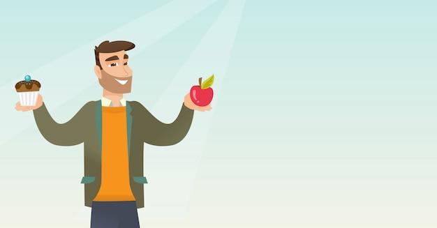 Homme choisissant entre pomme et cupcake.
