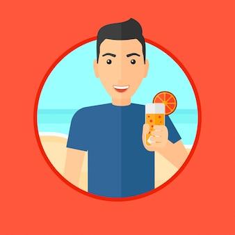Homme avec cocktail sur la plage.