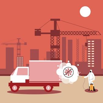 Homme en costume désinfectant des véhicules dans l'industrie