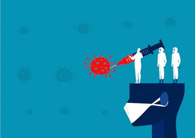 Un homme en costume de matières dangereuses organise de grosses injections pour lutter contre le coronavirus covid 19