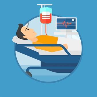 Homme couché dans un lit d'hôpital.