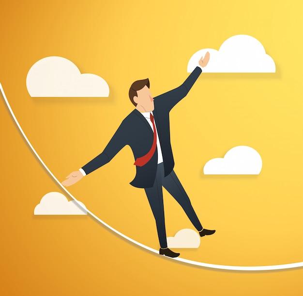 Homme en crise marchant en équilibre sur une corde