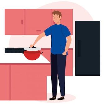 Homme cuisine sur scène cuisine avec tiroirs, réfrigérateur et fournitures