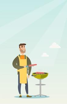 Homme cuisine steak sur la grille du barbecue.