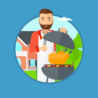 Homme de cuisson du poulet sur la grille du barbecue.