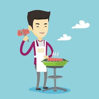 Homme, cuisson du steak sur la grille du barbecue.