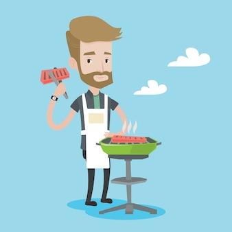 Homme, cuisson de la viande sur la grille du barbecue.
