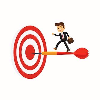 Homme d'affaires permanent sur dart pour atteindre l'objectif de l'entreprise