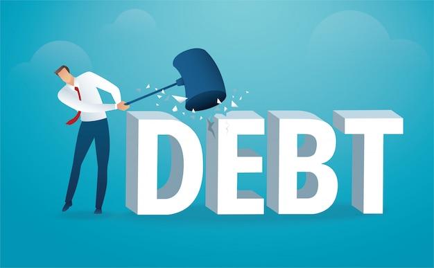 Homme détruisant le mot dette avec un marteau