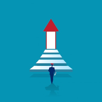 Un homme diplômé monte les escaliers vers la porte éclairante du succès