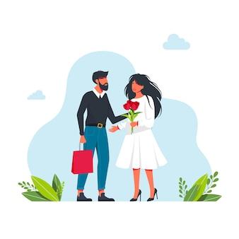 L'homme donne à la femme des fleurs et un cadeau. un homme mignon offre un cadeau à une femme avec un bouquet de fleurs. premier rendez-vous. illustration vectorielle plane de dessin animé. félicitations pour les vacances. illustration vectorielle
