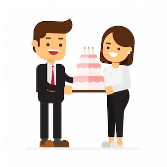 Un homme donne à une femme un gâteau en l'honneur de la saint-valentin