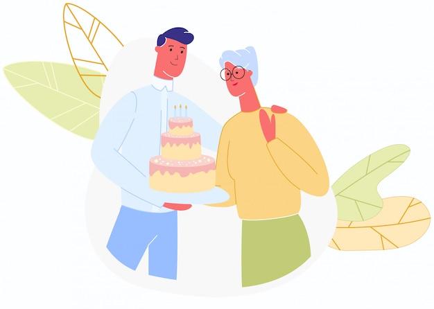 Homme donne un gâteau avec des bougies femme plus âgée
