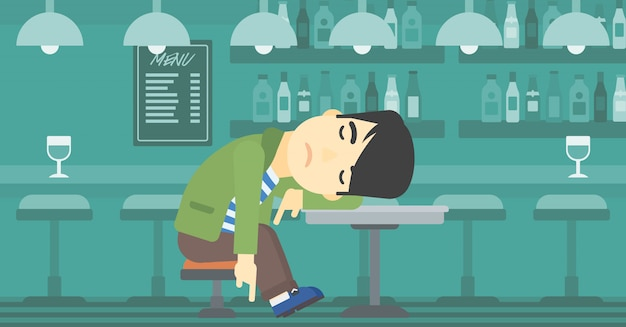Homme dormant dans un bar.