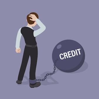Homme enchaîné à un grand bol avec l'inscription crédit
