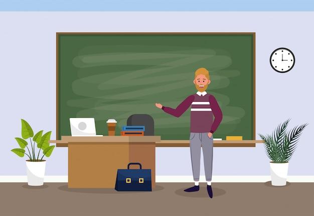 Homme enseignant avec ordinateur portable dans la salle de classe