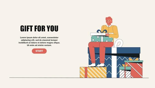Un homme est assis sur une grande boîte-cadeau. homme saluant avec joyeuses fêtes, joyeux anniversaire.