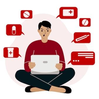 Un homme est assis les jambes croisées avec un ordinateur portable et commande en ligne des médicaments colère agressivité dépression