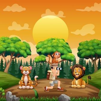 L'homme explorateur avec des animaux sur le terrain