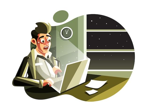 Homme faisant des heures supplémentaires dans la nuit au bureau
