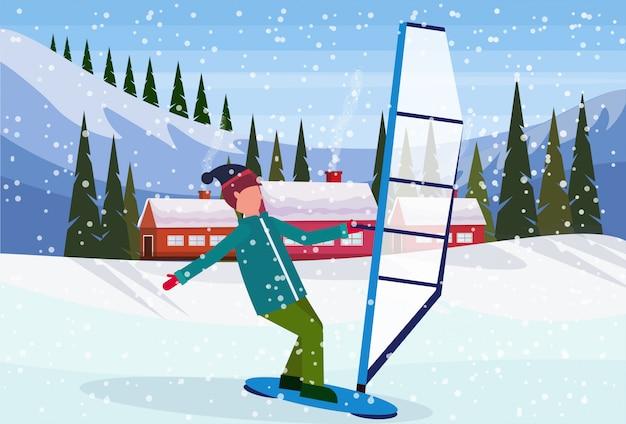 Homme faisant de la planche à voile dans la neige