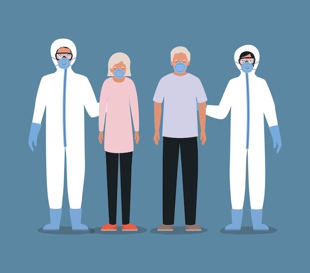 Homme et femme aînés avec des masques et des médecins avec des combinaisons de protection contre la conception de covid 19