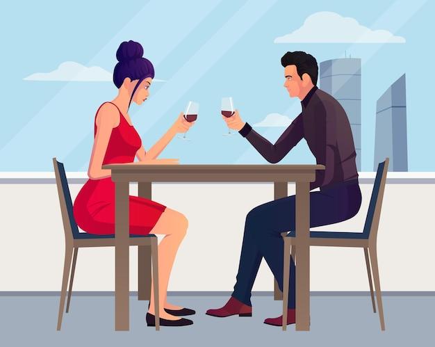 Homme et femme assis dans un restaurant, boire du vin rouge avec ciel et vue extérieure