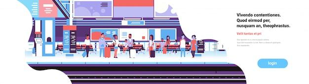 Homme femme en attente de la gare ferroviaire des passagers souterrain intérieur plat bannière copy space
