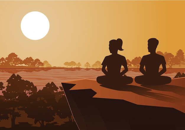 Un homme et une femme bouddhistes s'entraînent à la méditation