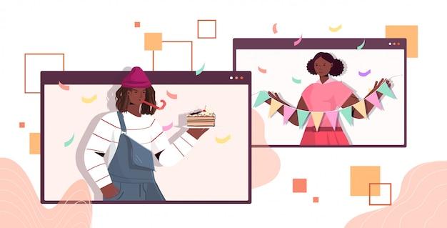 Homme femme en chapeaux festifs célébrant la fête d'anniversaire en ligne