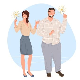 Homme et femme avec des cierges magiques à la main