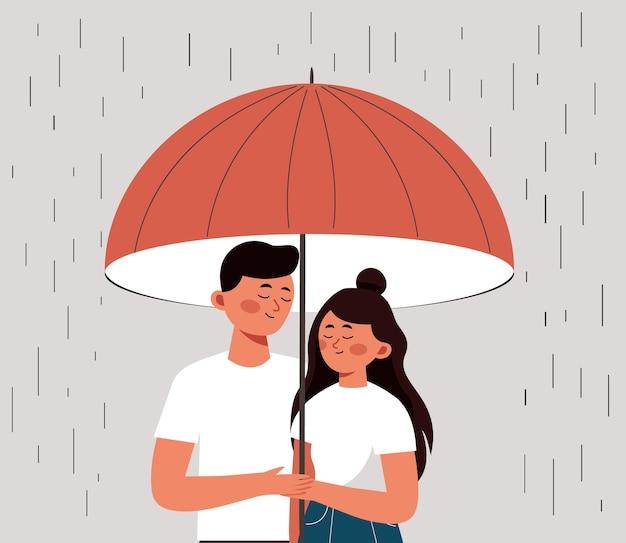 Un homme et une femme heureux se cachent de la pluie sous un parapluie ouvert