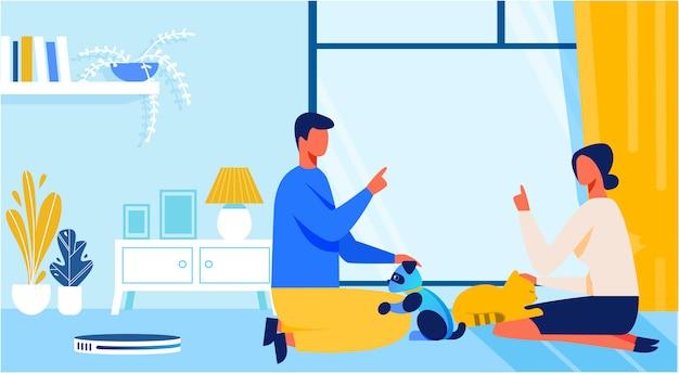 Homme et femme jouant avec un chat vivant ou artificiel