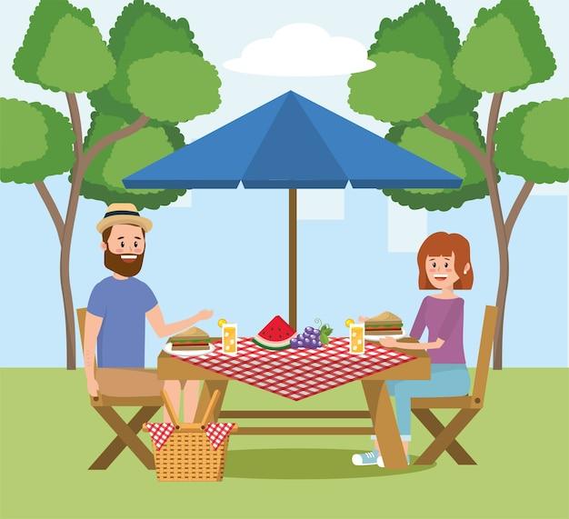 Homme et femme avec loisirs de pique-nique